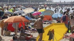 Holidaymakers on the beach at Arcachon, south-west France, earlier this month