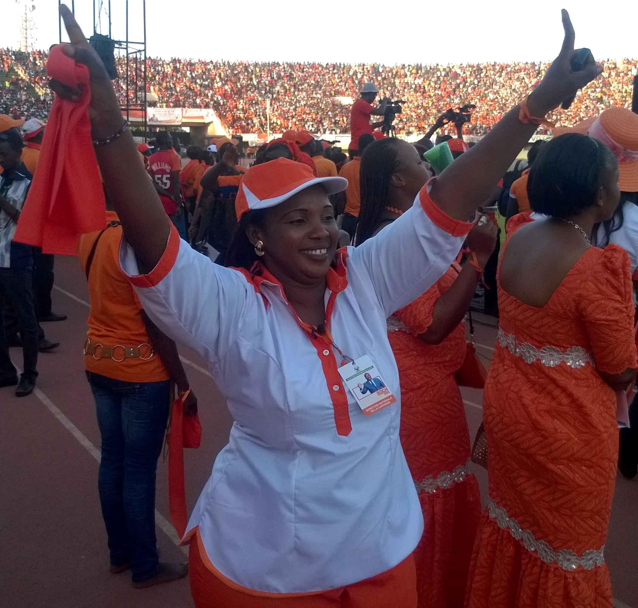 MPP supporter enjoys the music at Ouagadougou's 4th August stadium, 27 November 2015