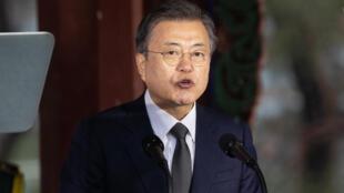 South Korean President Moon Jae-in, seen speaking in March 2021, has vowed to stop funding coal-powered plants overseas