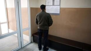 A man looks at a list with job vacancies at an employment agency in Vrasta, Bulgaria