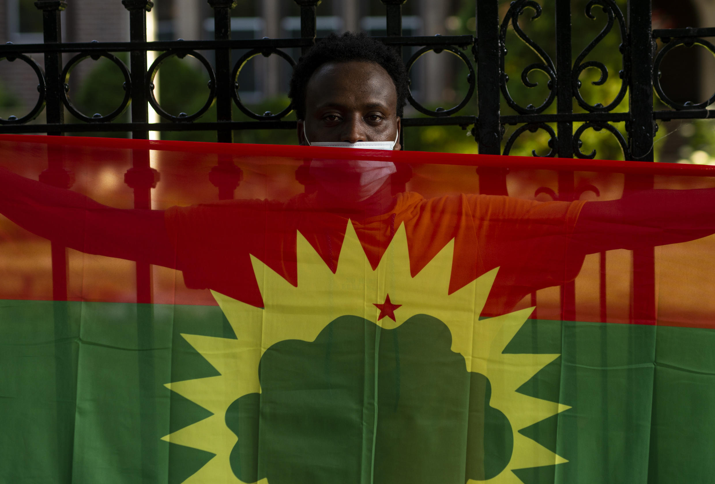 Protester holds up an Oromo flag during a demonstration about the killing of musician and activist Haacaaluu Hundeessaa, in St Paul, Minnesota on 30 June 2020.
