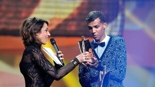 Stromae accepts the award for Male Artist of the year.