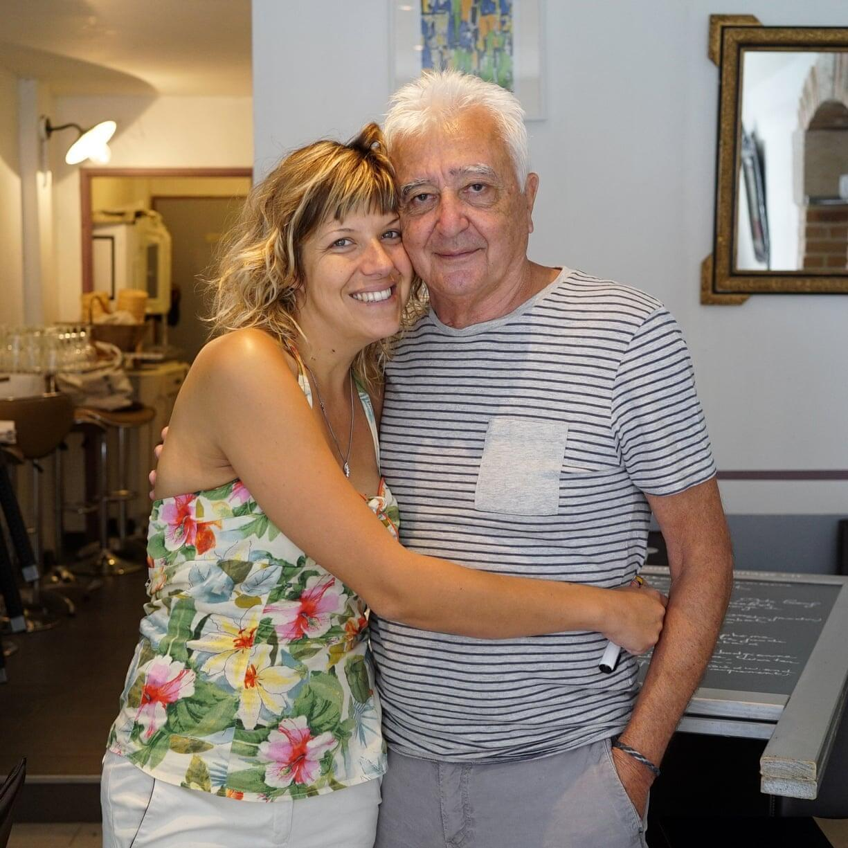 "Julie Lafourcade, 31, and Jean-Pierre Nouailles, 70, owners of the restaurant Le fromage Rit. ""We kept our relationship secret. When I was off at university and he came to pick me up at the train station, I would hide in the truck of his car so that nobody would see us."""