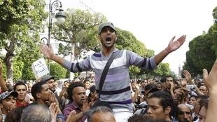 Protesters demonstrate against religious and political violence during a rally near the interior ministry in Tunis 22 October