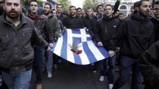 Манифестация в Афинах по случаю годовщины начала студенческого восстания против военной хунты в 1973 году. 17 ноября 2011