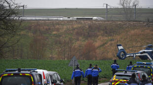 Police at the site where a TGV train derailed near Ingenheim, eastern France, on Thursday.