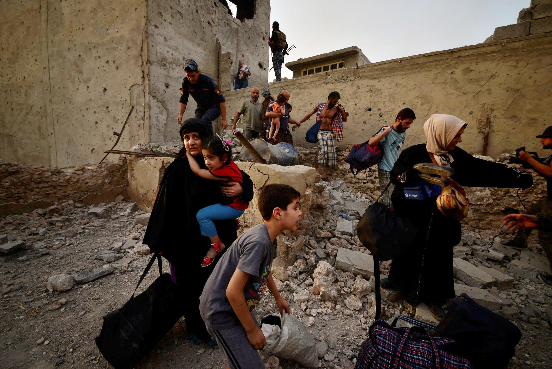 Fararen hula da ke neman tsira a yakin Mosul na Iraqi