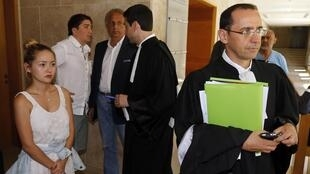 Mukhtar Ablyazov's daughter Madina (L), her husband Elias (2ndL) and lawyer Bruno Rebstock at a hearing in August