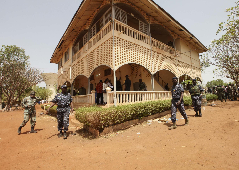 Malian junta soldiers walk in the yard of their headquarters in Kati, outside Mali's capital Bamako
