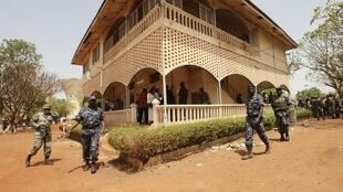 Malian junta soldiers walk in the yard of their headquarters in Kati, outside Mali's capital Bamako