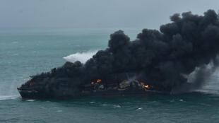A huge cloud of black smoke rises from the MV X-Press Pearl off Sri Lanka
