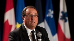 Former French Prime Minister François Hollande addresses a conference in Montreal, Canada, September 21, 2018.