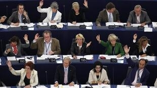 Members of the European Parliament take in a voting session in Strasbourg