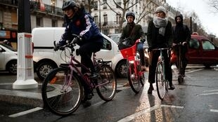 People ride bicycles during rush hour as a strike by all unions of the Paris transport network (RATP) and French SNCF workers entered its ninth consecutive day in Paris, France, December 13, 2019.