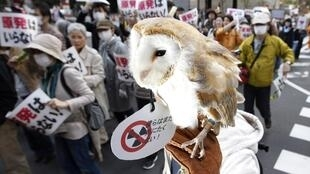 An anti-nuclear protester during a march in front of Tokyo Electric Power Company HQ