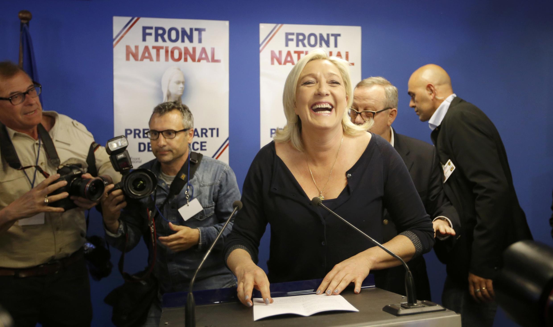 Лидер Нацфронта Франции Марин Ле Пен при объявлениие результатов выборов 25 мая 2014