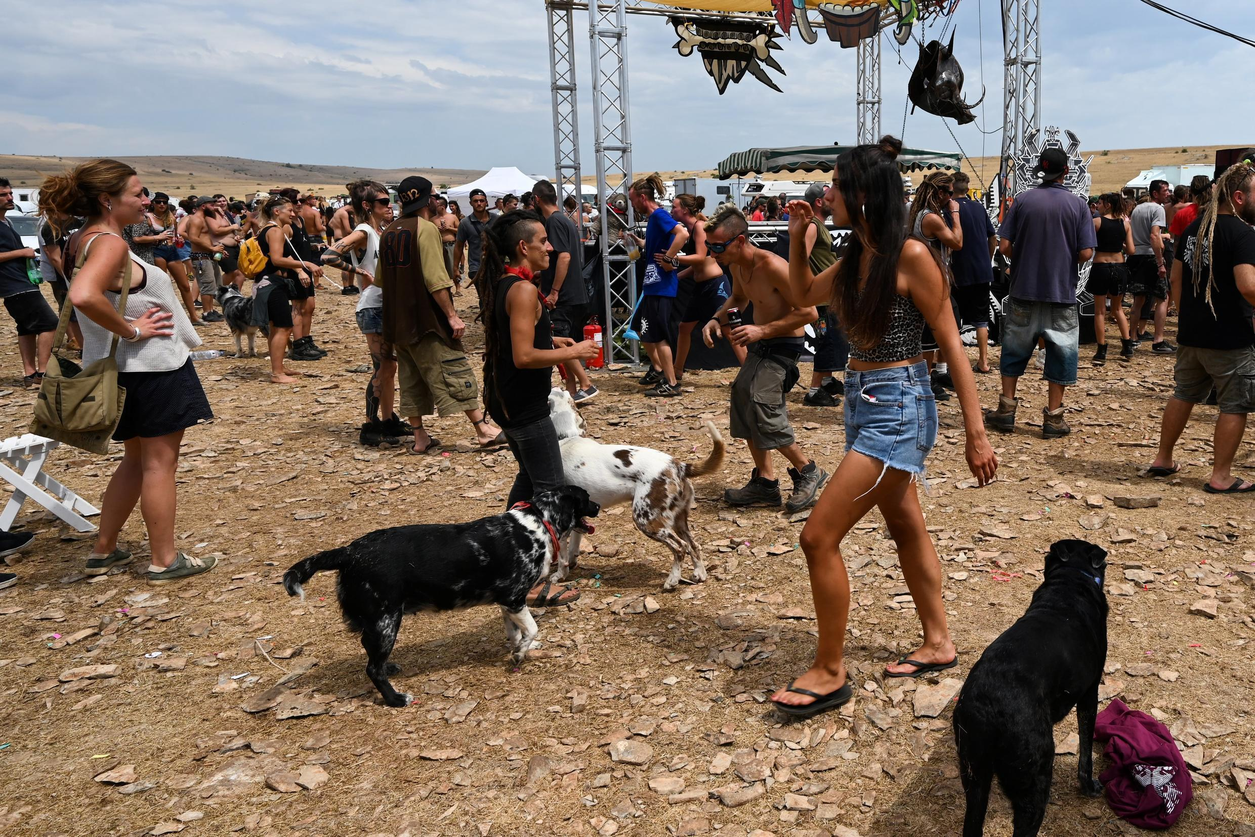 People dance and attend a rave party, on agricultural land in Causse Mejean, in the heart of the Cevennes National Park, southern France on 10 August 2020, despite the limitations on gatherings linked to COVID-19.