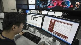 A photo taken on May 15, 2017 shows staff monitoring the spread of ransomware cyber-attacks at the Korea Internet and Security Agency (KISA) in Seoul More cyberattacks could be in the pipeline after the global havoc caused by the Wannacry ransomware, a Sou
