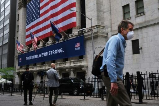 The New York Stock Exchange, the symbolic heart of Wall Street, reopened its floor after a two-month closure due to the coronavirus, with traders donning masks and separated by plexiglas