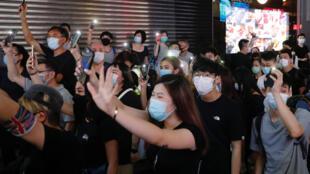 2020-06-12T000000Z_1871012231_RC2O7H9OZI44_RTRMADP_3_HONGKONG-PROTESTS