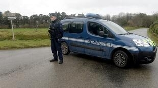 Police block access to the read near Brest, France where Charlotte Troadec's national health insurance card was found on March 1, 2017.
