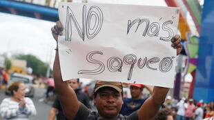A protester in Nicaragua calls for the government to stop pillaging the country, during a demonstration against social security reform 22 April 2018.