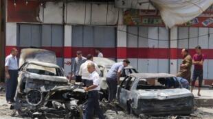 """محل بمبگذاری در شهر """"طور خورماتو"""" در شمال عراق دوشنبه ١٩ خرداد ٩ ژوئن ٢٠١٤."""