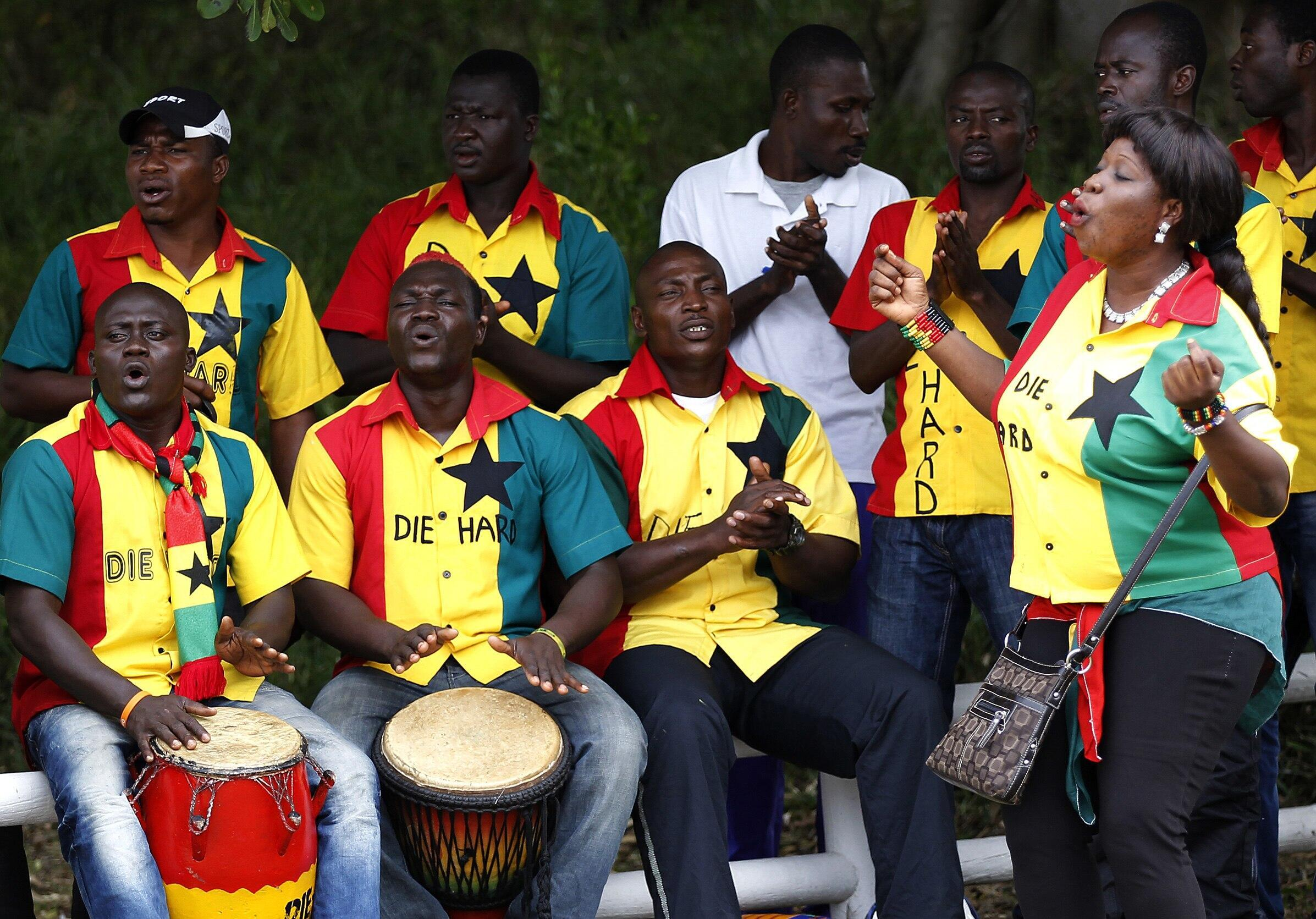 Supporters of Ghana's national football team sing during the team's training session in Port Elizabeth