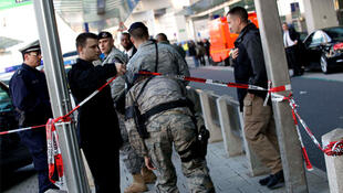 US soldiers arrive on the scene of the shooting at Frankfurt airport.