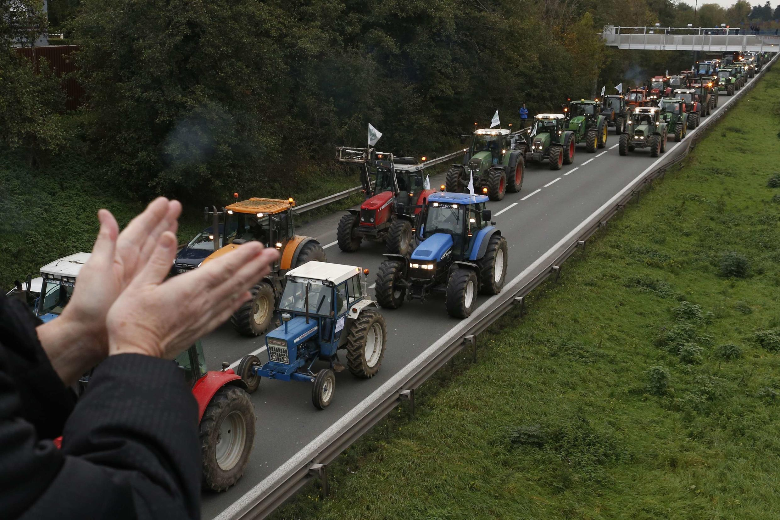 Farmers obstruct traffic on the Brussels-Paris motorway in Valenciennes on Friday