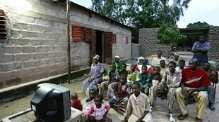 Watching solar powered TV in Mali