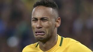 Brazilian star Neymar cries on the field following Brazil's win against Germany on Saturday.