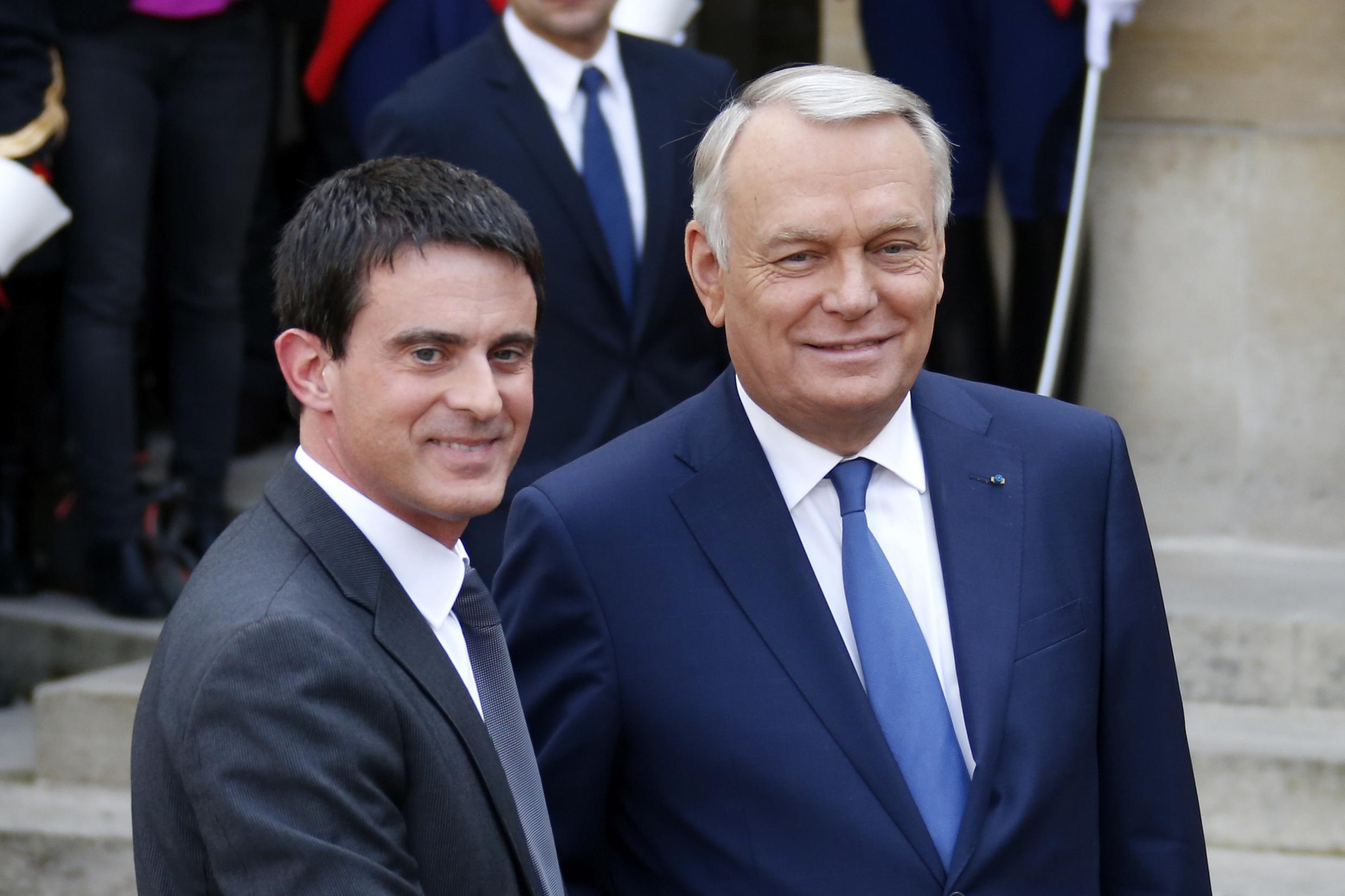 Manuel Valls (L) with Jean-Marc Ayrault  at Tuesday's handover ceremony