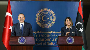 Turkish Foreign Minister Mevlut Cavusoglu (L) and Libya's Foreign Minister Najla al-Mangoush hold a press conference in the capital Tripoli on May 3, 2021