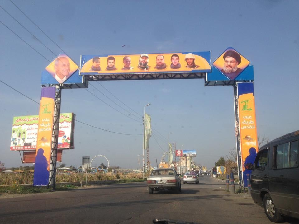 Signs depicting Hezbollah leader Hassan Nasrallah line the roads in southern Lebanon's shia heartland