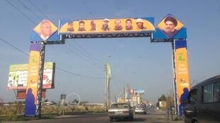Signs depicting Hezbollah leader Hassan Nasrallah line the roads in southern Lebanon's shia heartland