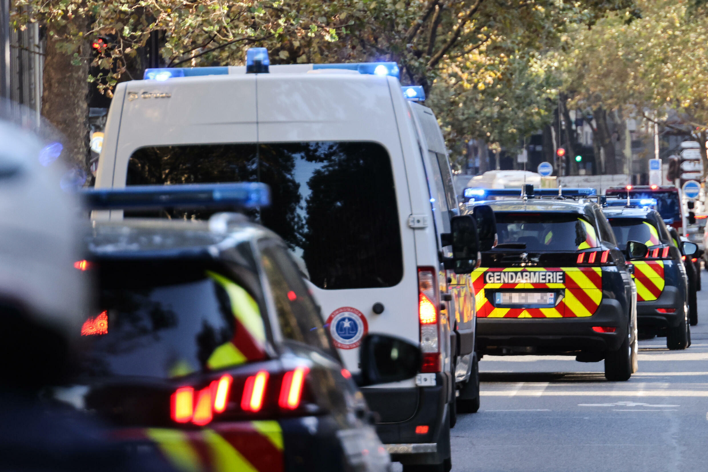 French police escort a convoy understood to be transporting main defendant Salah Abdeslam for his trial over the November 13, 2015 Paris attacks