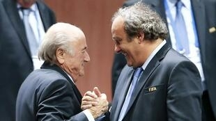 Uefa president Michel Platini congratulates Sepp Blatter on his re-election at Fifa congress in Zurich, 29 May 2015