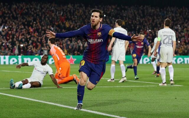 Lionel Messi yana murnar zura kwallo ta biyu da ya ci a wasan zakarun turai da Barcelona ta lallasa Chelsea da 3-0 a filin wasa na Camp Nou.