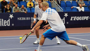 Former rivals John McEnroe and Stefan Edberg team up for a doubles match at the 2010 Trophée Jean-Luc Lagardère.
