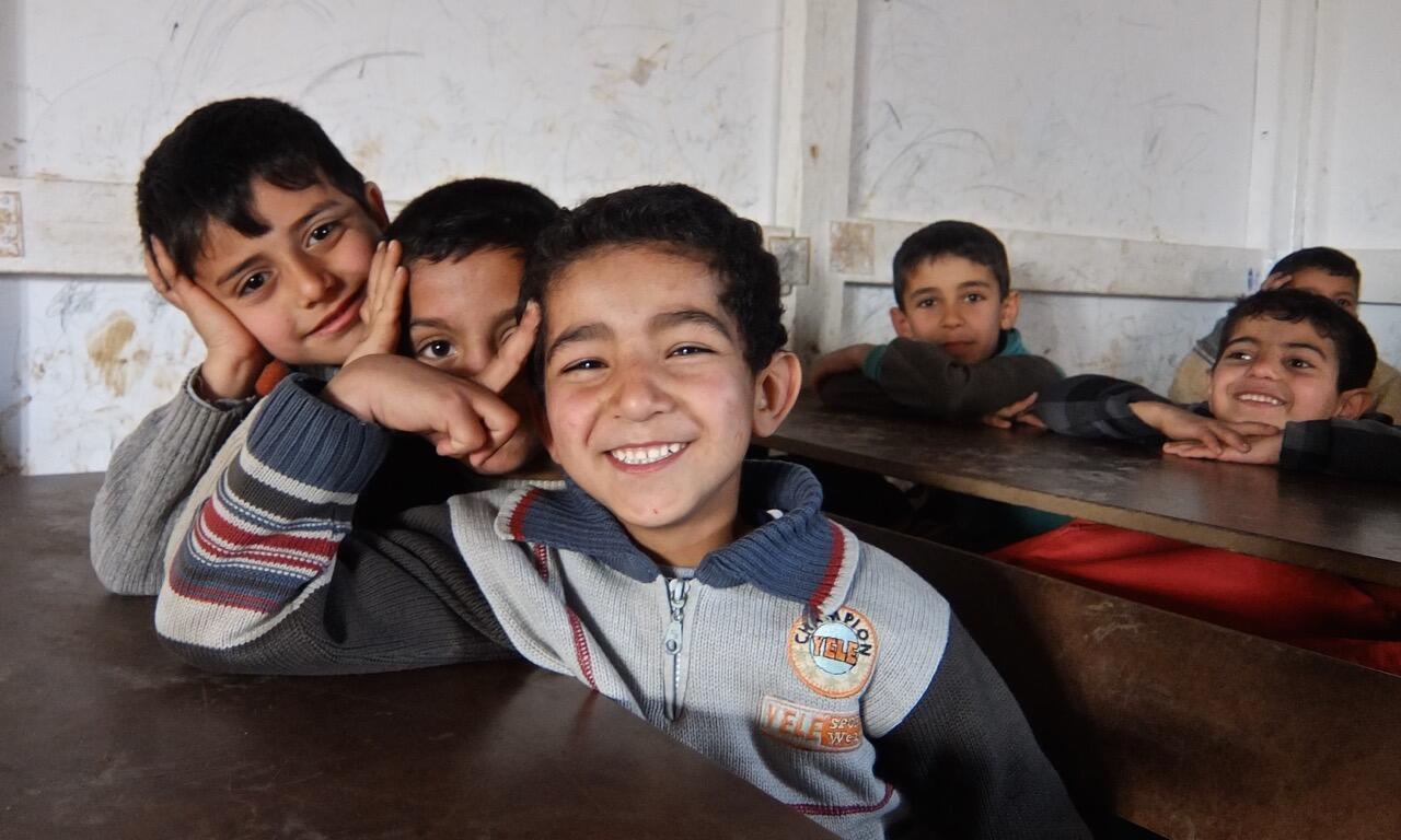 Children enjoying class at volunteer-run school for refugees in northern Lebanon