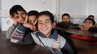 Children enjoying class at volunteer-run school for refugees in northern Lebanon