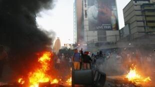 Protestos pro e contra governo nas ruas de Caracas. 12 de Fevereiro de 2014.