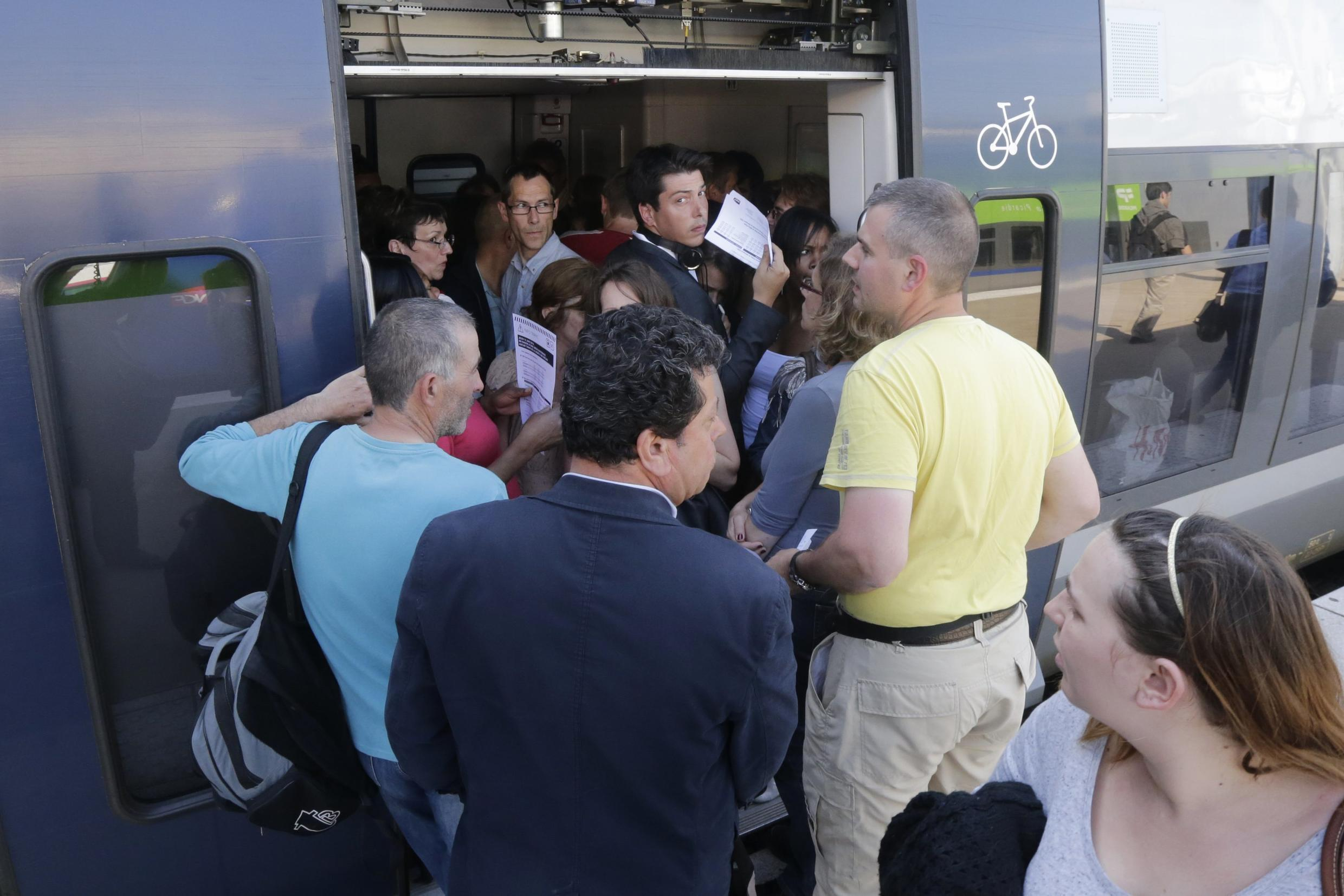 Passengers cram into a train at Paris's Gare du Nord on Wednesday