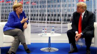 Donald Trump lors d'une rencontre avec Angela Merkel au sommet de l'Otan à Bruxelles, le 11 juillet 2018.