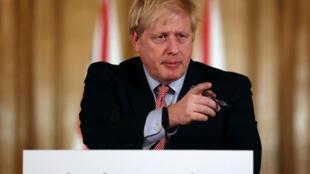 Britain's Prime Minister Boris Johnson announced new measures to halt the coronavirus outbreak