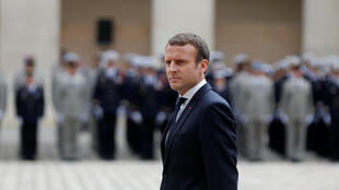 French President Emmanuel Macron reviews troops during a military ceremony at the Hotel des Invalides in Paris, France, June 30, 2017.