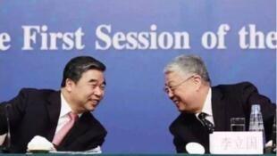 中國民政部前部長李立國(右)和前副部長竇玉沛(左)