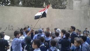 叙利亚大学生在首都大马士革反对反政府示威。2011年9月29日。