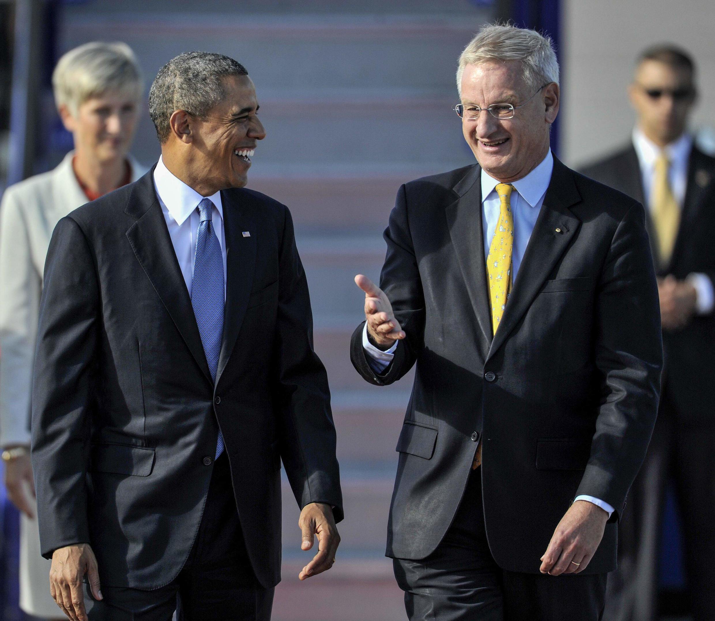 Ngoại trưởng Thụy Điển Carl Bildt tiếp đón Tổng thống Mỹ Barack Obama - REUTERS
